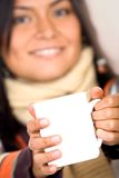 Casual girl holding a mug Royalty Free Stock Photography