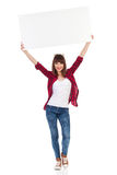 Casual Girl Holding Placard Over Her Head Stock Images