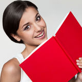 Casual girl holding red book Stock Image