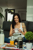 Casual girl at home take the breakfast Royalty Free Stock Images