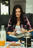 Casual girl at home take the breakfast Royalty Free Stock Photos