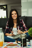 Casual girl at home take the breakfast Royalty Free Stock Photography