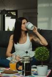 Casual girl at home take the breakfast Stock Image