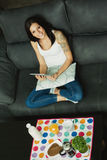 Casual girl at home taking the breakfast and reading the tablet Royalty Free Stock Images