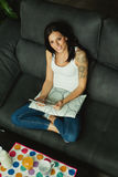 Casual girl at home taking the breakfast and reading the tablet Royalty Free Stock Photography