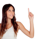 Casual girl indicating something with her finger Stock Images