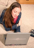 Casual girl on laptop Stock Image