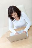 Casual girl on a laptop Royalty Free Stock Photos