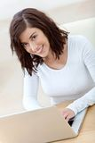 Casual girl on a laptop Stock Images