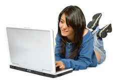 Casual girl on a laptop Stock Photos