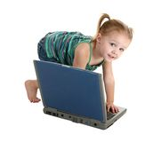 Casual Girl with Laptop. Adorable 2 year old girl playing with laptop over white stock photo