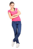 Casual girl leaning against a wall Royalty Free Stock Photos