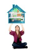 Casual girl lifting a piggyhouse Stock Photos