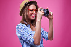 Casual girl looks at lens of the camera while taking photo stock photo