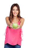 Casual girl with offering a green apple. Isolated on a white background Royalty Free Stock Photography