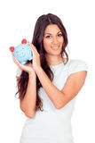 Casual girl with a piggy-bank Royalty Free Stock Photos