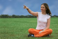 Casual girl pointing towards screen - sally Royalty Free Stock Photo