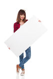 Casual Girl Posing With White Placard Stock Photo