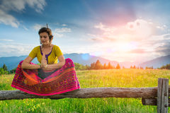 Casual girl relaxes doing stretching Royalty Free Stock Photo