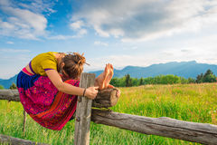 Casual girl relaxes doing stretching Stock Image