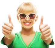 Casual girl showing thumbs up and smiling Stock Photo