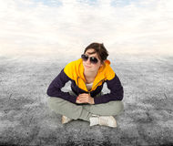 Casual girl sitting on a floor Stock Photography