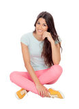 Casual girl sitting on the floor Royalty Free Stock Image