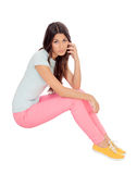 Casual girl sitting on the floor Royalty Free Stock Photos