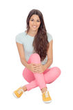 Casual girl sitting on the floor Stock Photography