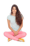 Casual girl sitting on the floor Royalty Free Stock Images