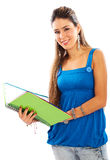 Casual girl smiling with a notebook Royalty Free Stock Image