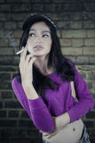 Casual girl smoking a cigarette Royalty Free Stock Images
