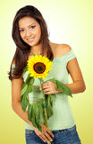 Casual girl with a sunflower Stock Image