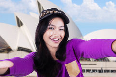 Casual girl taking picture at Opera House Royalty Free Stock Photos
