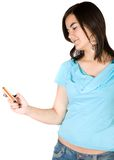 Casual girl texting on a mobile phone Royalty Free Stock Photo