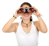 Casual girl using binoculars Stock Photo