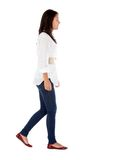 Casual girl walking Royalty Free Stock Photos
