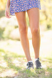 Casual girl walking in the park Royalty Free Stock Photography