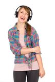 Casual girl wearing headphones Royalty Free Stock Images