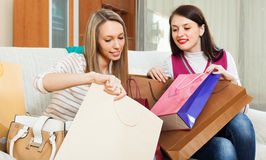 Casual girls looking purchases Stock Images