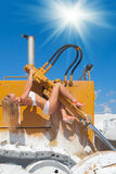 Casual glamour. Hot and sexy on snowy dozer Royalty Free Stock Image