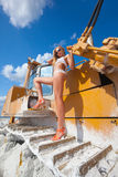 Casual glamour. Hot and sexy on snowy dozer Royalty Free Stock Photography
