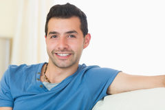 Casual good looking man relaxing on couch Stock Photography
