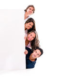 Casual group with a banner Royalty Free Stock Photography