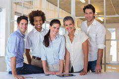 Casual group of coworker friends smiling Stock Images