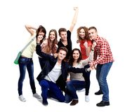 Casual group of excited friends isolated. On white Royalty Free Stock Image