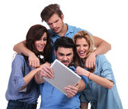 Casual group of friends reading bad news on tablet. Pad computer, on white background Royalty Free Stock Photo