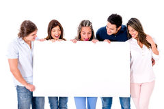 Casual group holding a banner Stock Images