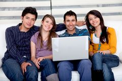 Casual group with laptop Stock Image
