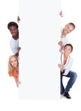 Casual group of people with placard Royalty Free Stock Photo